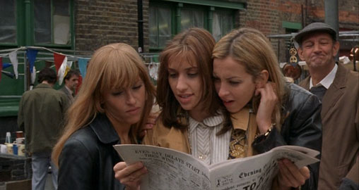 'The All Saints eagerly examine the papers for reviews of their film.